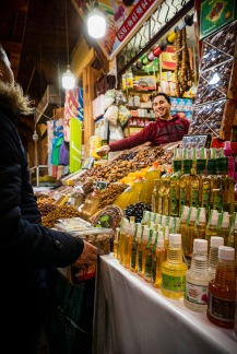 Souk man sells dates fragrant waters to L